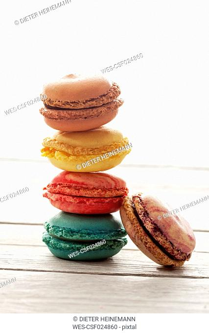 Stacked colorful macarons on wood