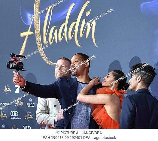 """11 May 2019, Berlin: Actor Will Smith (l-r), director Guy Ritchie, actress Naomi Scott and actor Mena Massoud at the gala screening of the film """"""""Aladdin"""""""" at..."""