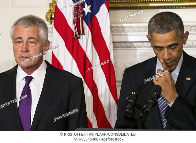 United States President Barack Obama, right, announces the resignation of Secretary of Defense Chuck Hagel, left, in the State Dining Room of the White House in...