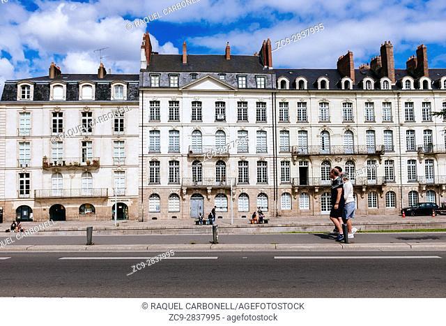 Tourists walking by beautiful architecture building, Nantes, Loire-Atlantique, Pays de la Loire, France
