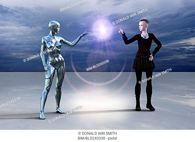 Silver female cyborg and woman pointing at glowing light