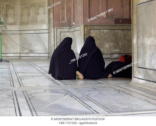 Muslim women praying at Jama Masjid mosque