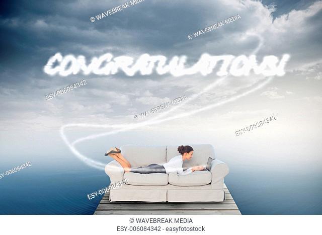 Congratulations! against cloudy sky over ocean