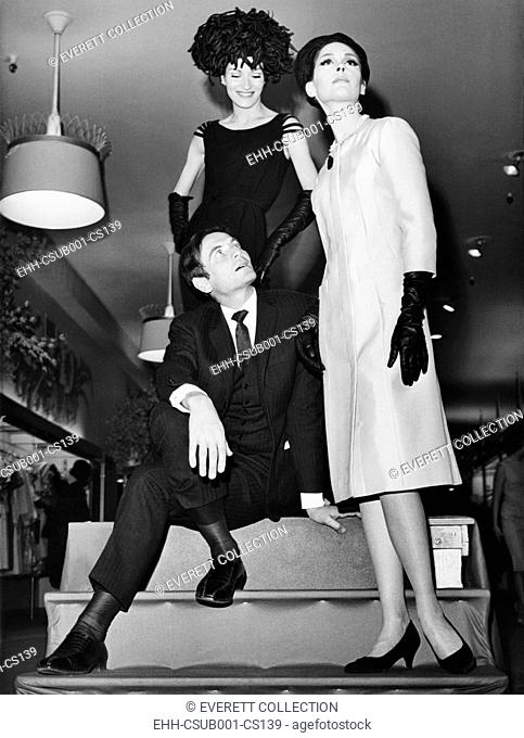 Pierre Cardin, Italian-born French fashion designer, with models at Bonwit Teller. The couturier's appearance coincided with a Spring collection he designed...