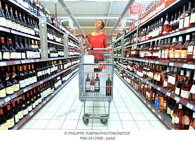 France, woman in a supermarket during wine fair