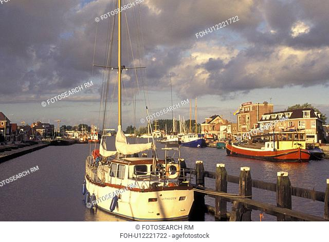 Netherlands, Holland, Groningen, Delfzijl, North Sea, Europe, Boats docked along the harbor of Delfzijl on the North Sea
