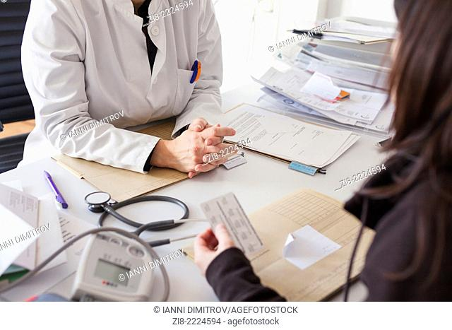 Doctor prescribes medication to patient