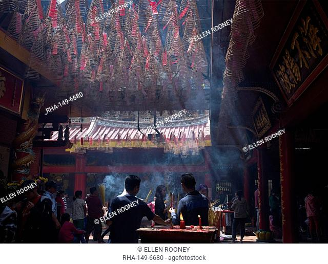 Worshippers inside the Chua On Lang Pagoda in Ho Chi Minh City, Vietnam, Indochina, Southeast Asia, Asia