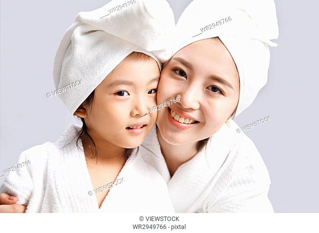 Happy mother and daughter in a bath
