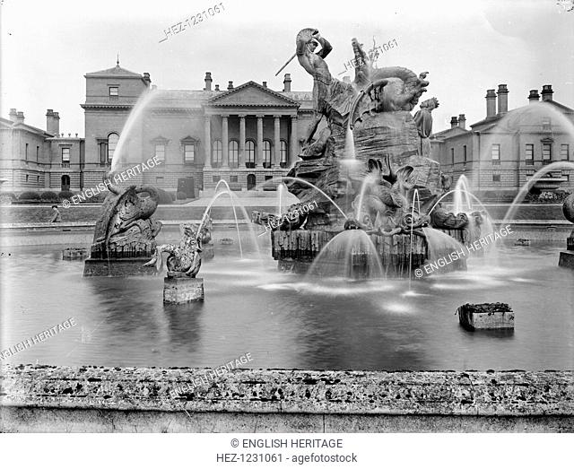 A fountain with sculpture depicting Perseus and Andromeda at Holkham Hall, Norfolk, February, 1929. The fountain was designed by Charles R Smith circa 1850