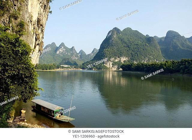 Boat moored on the banks of the River Li in Xinping, Guangxi, China
