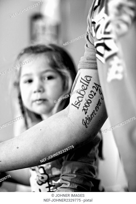 Tattoo on arm, girl on background