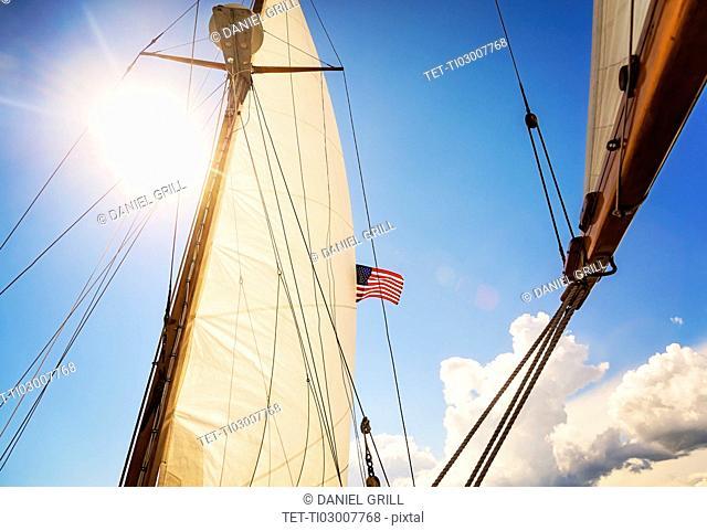 Close-up of sun shining through boat's sail