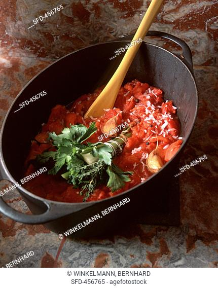 Tomato coulis in a pot