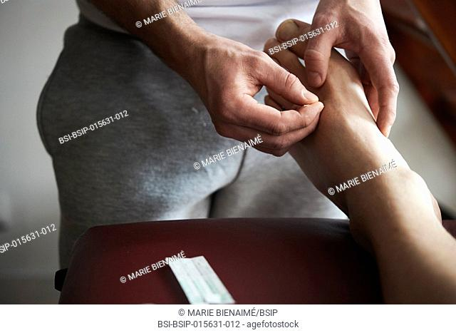 Reportage in a Chinese medicine practice in Lyon, France. Acupuncture session