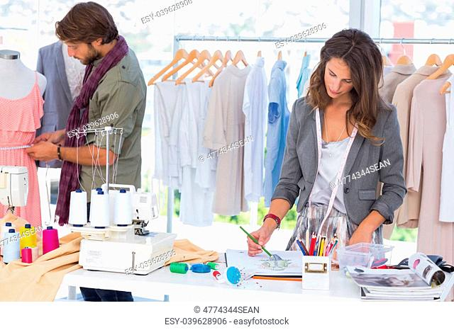 Fashion designers working in a bright office