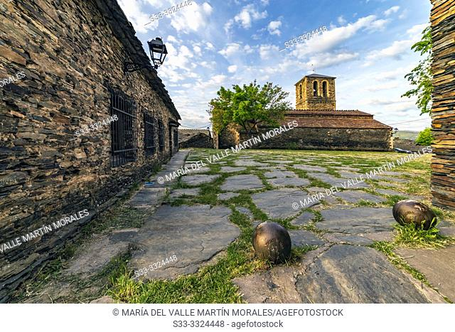 Church, cobblestone square and streetlight at Campillo de Ranas. Guadalajara. Spain. Europe