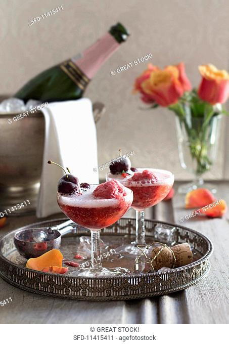 Berry sorbet in champagne with cherries