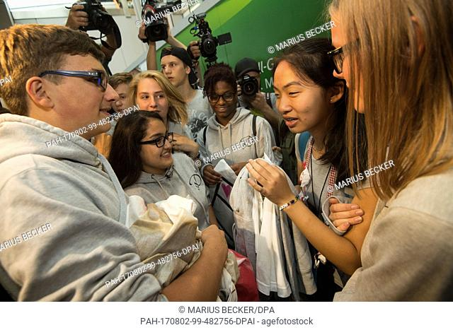 Schoolgirl Bivsi Rana (2nd from right) arrives to the airport and is greeted by classmates in Dusseldorf, Germany, 02 August 2017