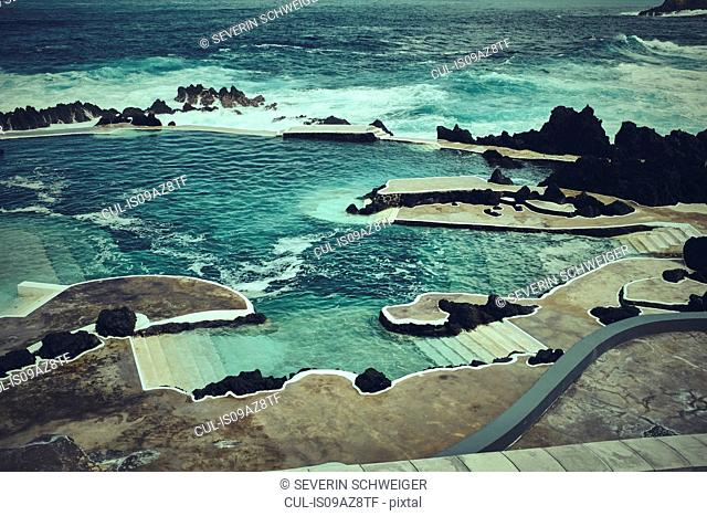 Elevated view of concrete steps into ocean, Madeira, Porto Moniz, Portugal
