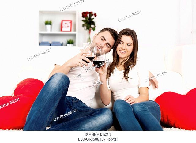 Romantic couple drinking wine at home Debica, Poland