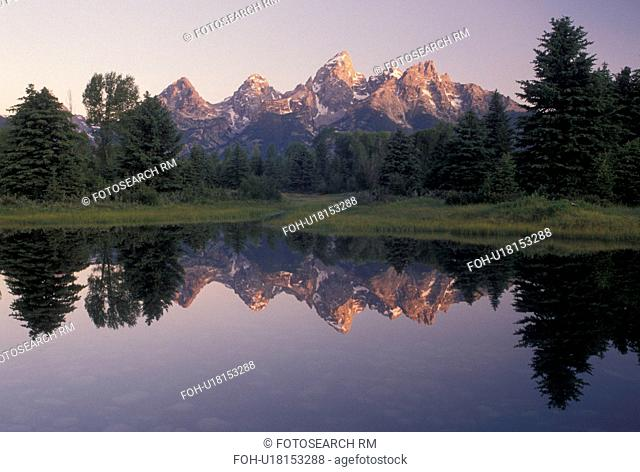 Grand Teton National Park, Snake River, Jackson Hole, WY, Wyoming, Scenic view of the Grand Teton Mountains reflecting in the calm waters of the Snake River at...