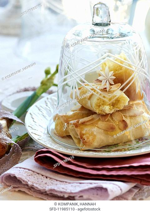 Almond filo pastries under a bell jar