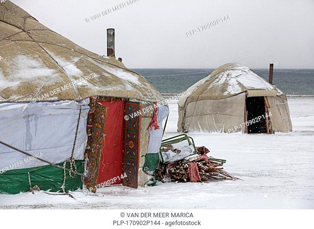 Yurts in traditional Kyrgyz yurt camp during snow storm along Song Kul / Song Kol lake in the Tian Shan Mountains, Naryn Province, Kyrgyzstan