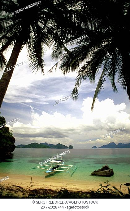 Bangka boat on a beach. Cudugman Island. Bacuit archipelago. El Nido Palawan. Philippines. Cudugman Point is a point and is located in Province of Palawan