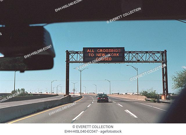 'All Crossings to New York Closed' reads a highway sign on Sept. 11, 2001. At 9:21 AM, 18 minutes after the second plane flew into the World Trade Center