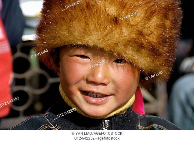 Tibetan boy. Festival. Danba. Sichuan
