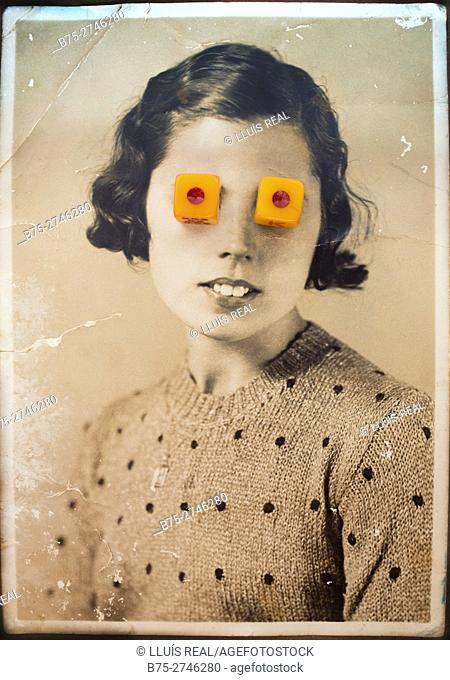 Old black and white portrait of woman looking at camera with dice on her eyes