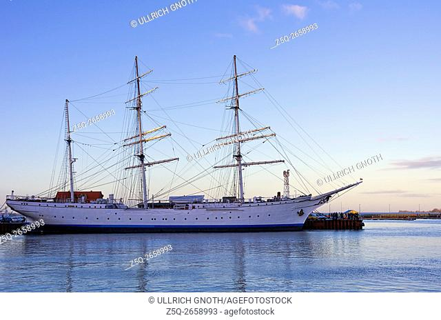 The former sail training vessel Gorch Fock I in the port of the Hanseatic City Stralsund, Germany, at sundown