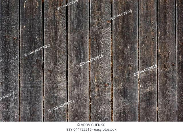 Old dark wooden grunge planks. Close up