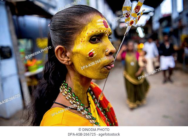 Woman tongue pierced with spear near Mutharamman temple, Tamil Nadu, India, Asia