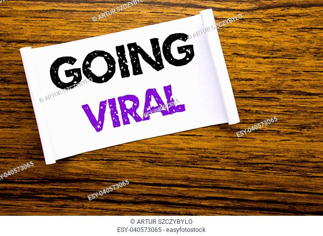 Word, writing Going Viral. Business concept for Social Viral Business written on sticky note paper on wooden wood structure visible background