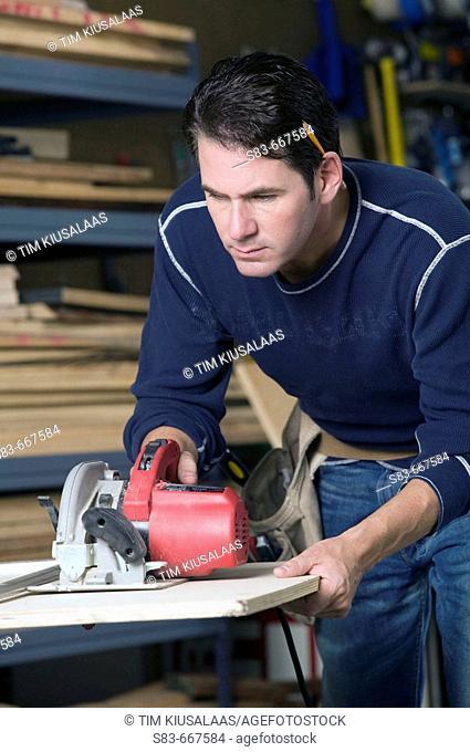 Man cutting wood with a circular saw