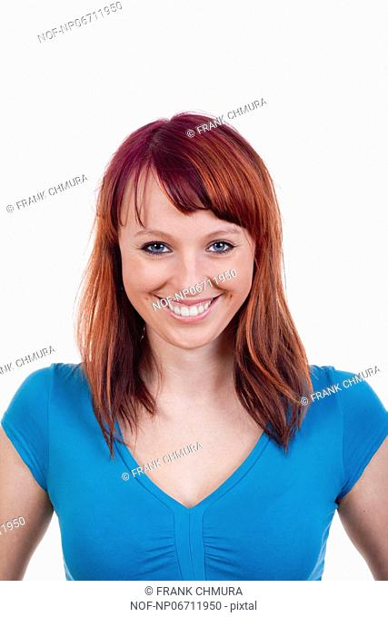 portrait of a young woman with red hair - isolated on white