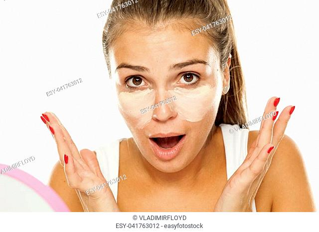 young women posing with concealer under the eyes