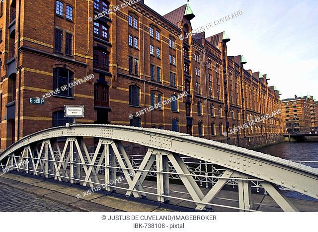 Storehouses in the Speicherstadt warehouse district and the Kannengiesserort Bridge, Hamburg, Germany