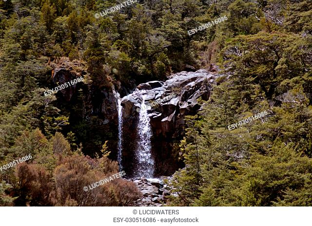 NATIONAL PARK, NZ - DEC 8 2014:Mangawhero falls in Tongariro National Park.The Tongariro Alpine Crossing is one of New Zealand's top tramping experiences and...
