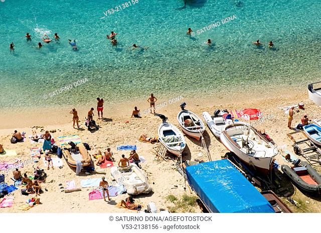 Bathers on the beach of San Nicola island, Tremiti islands, Puglia (Apulia), Italy