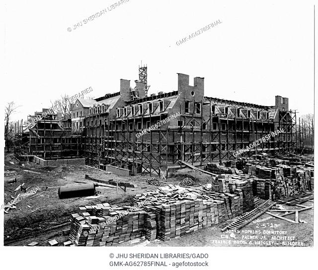 Alumni Memorial Residences Exterior shot of AMR, Scaffolding around the back of building, Stacks of construction material in the foreground, 1923