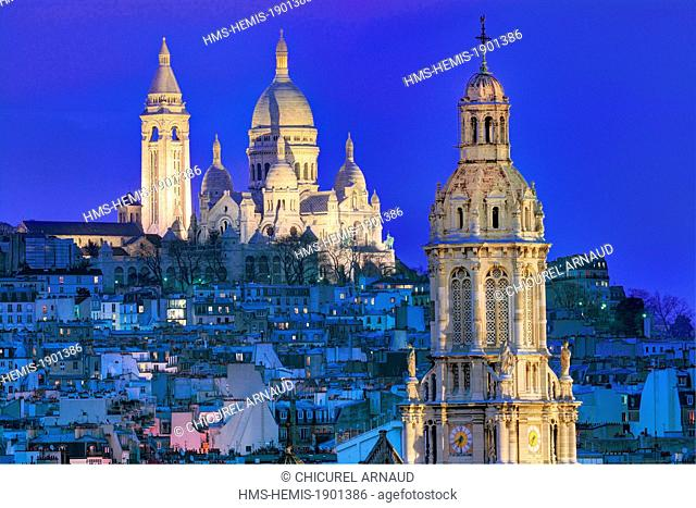 France, Paris, the basilica of the Sacré-Coeur of Montmartre and the bell-tower of Sainte-Trinité (Holy Trinity) church