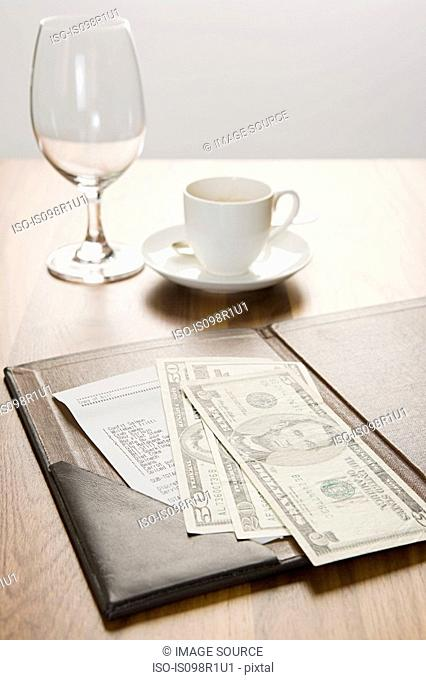 The bill on a table
