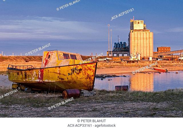 An old boat sits on the shore, Port of Churchill, Manitoba, Canada