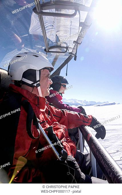 Austria, Vorarlberg, Damuels, man and woman in ski lift