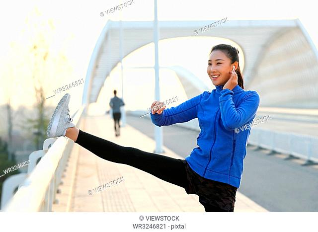 Outdoor fitness young woman