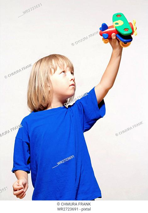 activity, aircraft, airplane, aviation, boy, Caucasian, child, childhood, dream, fun, game, holding, isolated, kid, leisure, little, long, male, model, person