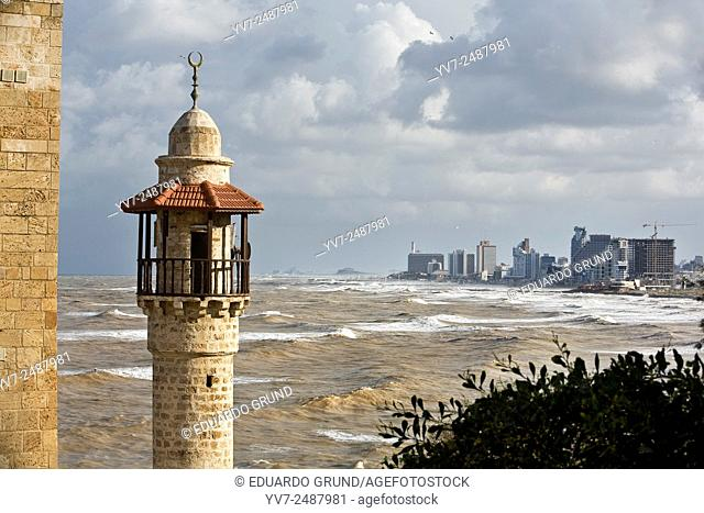 View of the coast from Tel Aviv from Yaffa with an Arabic minaret in foreground. Tel Aviv, Israel, Asia